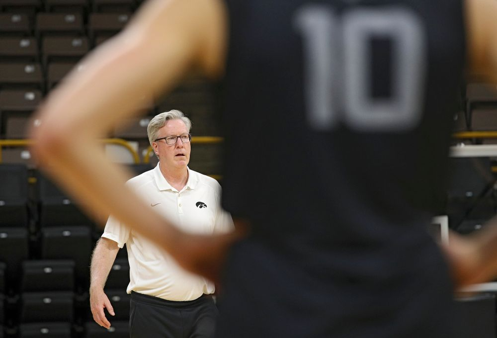 Iowa Hawkeyes head coach Fran McCaffery talks with his players as guard Joe Wieskamp (10) looks on during practice at Carver-Hawkeye Arena in Iowa City on Monday, Sep 30, 2019. (Stephen Mally/hawkeyesports.com)