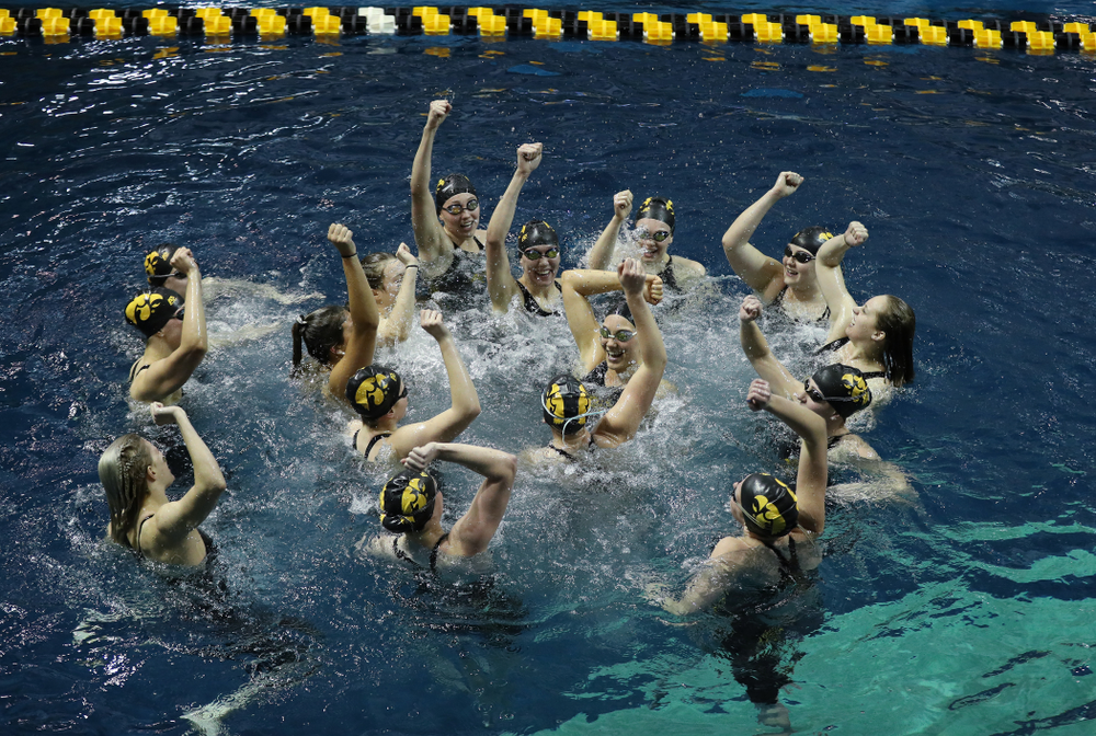 The Iowa Hawkeyes swim the Fight Song following their win over the Iowa State Cyclones in the Iowa Corn Cy-Hawk Series Friday, December 7, 2018 at at the Campus Recreation and Wellness Center. (Brian Ray/hawkeyesports.com)