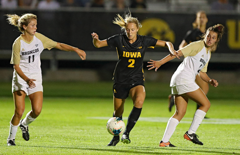 Iowa midfielder Hailey Rydberg (2) moves between two defenders during the second half of their match against Western Michigan at the Iowa Soccer Complex in Iowa City on Thursday, Aug 22, 2019. (Stephen Mally/hawkeyesports.com)