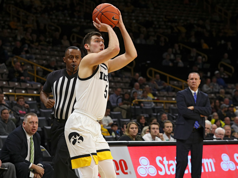 Iowa Hawkeyes guard CJ Fredrick (5) makes a 3-pointer during the first half of their exhibition game against Lindsey Wilson College at Carver-Hawkeye Arena in Iowa City on Monday, Nov 4, 2019. (Stephen Mally/hawkeyesports.com)