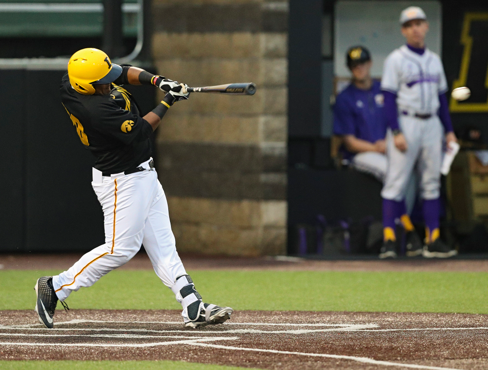 Iowa Hawkeyes first baseman Izaya Fullard (20) drives in a run with a hit during the fourth inning of their game against Western Illinois at Duane Banks Field in Iowa City on Wednesday, May. 1, 2019. (Stephen Mally/hawkeyesports.com)