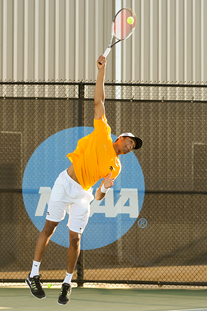 Iowa's Oliver Okonkwo serves during their doubles match again Michigan State at the Hawkeye Tennis and Recreation Complex in Iowa City on Friday, Apr. 19, 2019. (Stephen Mally/hawkeyesports.com)