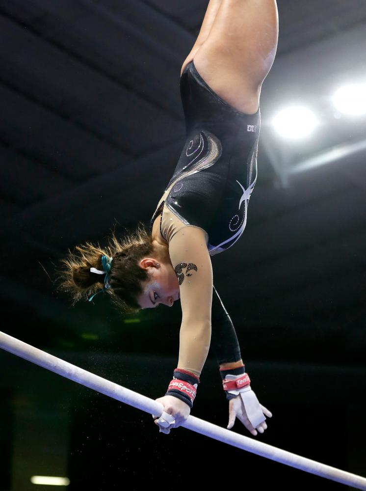 Iowa's Erin Castle competes on the bars against the Nebraska Cornhuskers