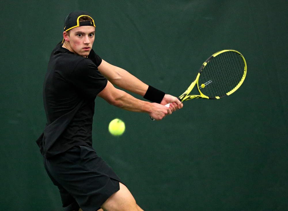 Iowa's Joe Tyler returns a shot during his singles match at the Hawkeye Tennis and Recreation Complex in Iowa City on Friday, March 6, 2020. (Stephen Mally/hawkeyesports.com)