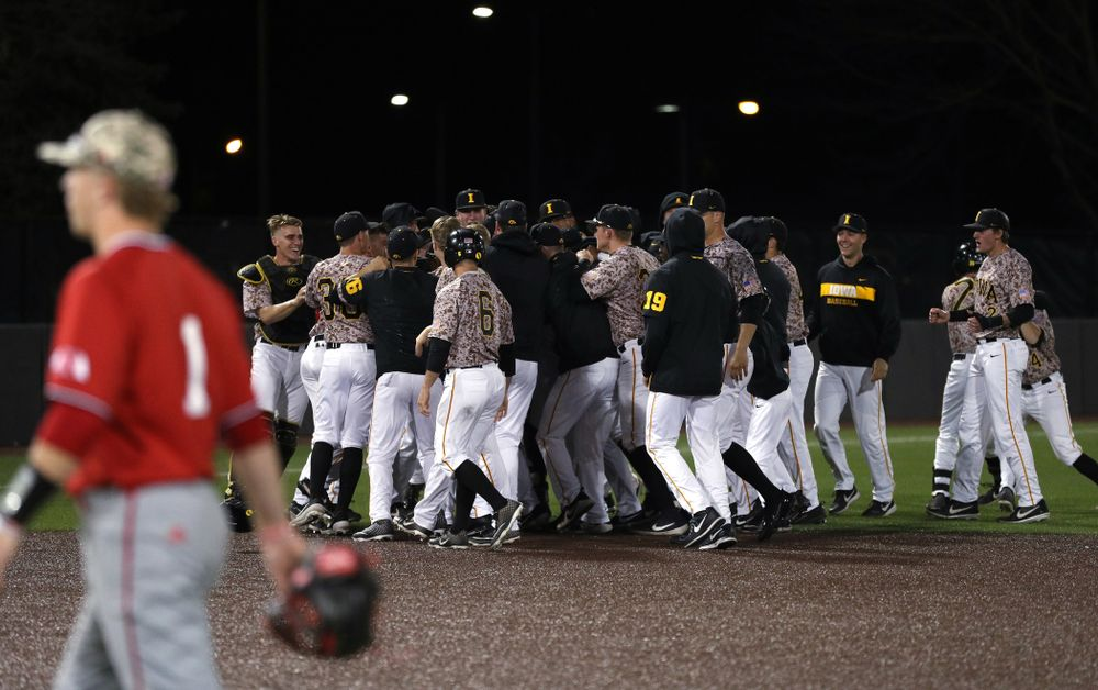 The Iowa Hawkeyes celebrate their walk off win against the Nebraska Cornhuskers on Military Appreciation Night Friday, April 19, 2019 at Duane Banks Field. (Brian Ray/hawkeyesports.com)