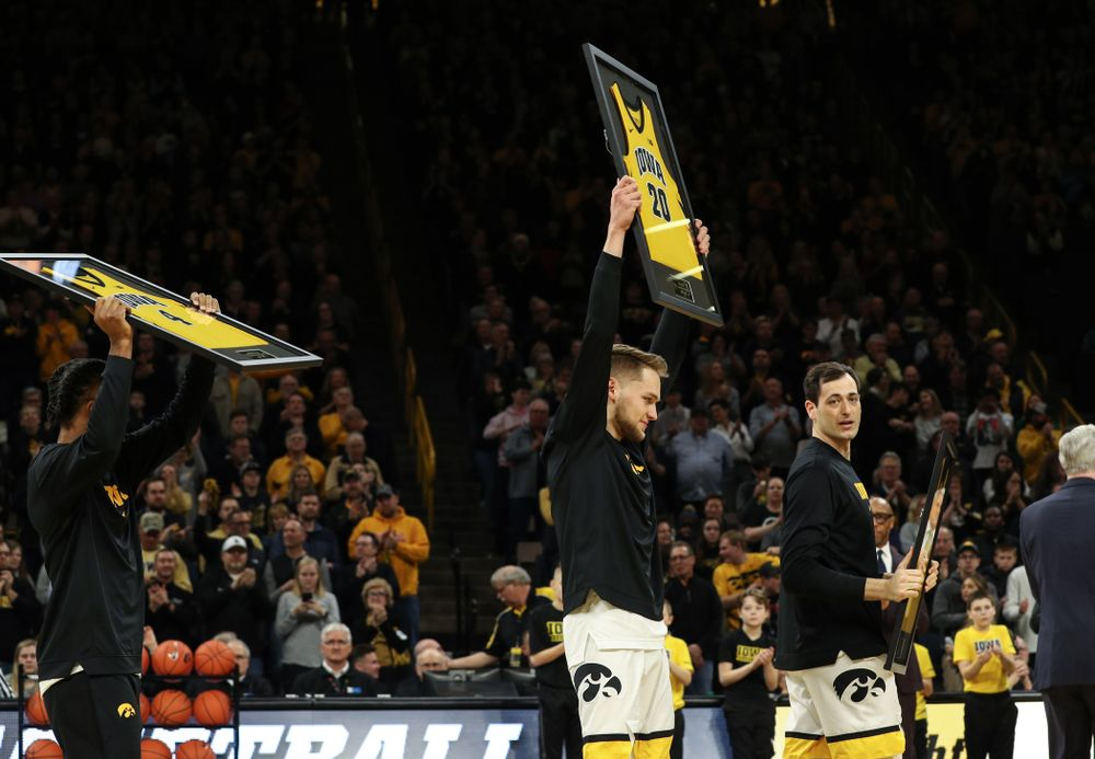 Iowa Hawkeyes forward Riley Till (20) holds up his jersey during senior night activities before their game against the Purdue Boilermakers Tuesday, March 3, 2020 at Carver-Hawkeye Arena. (Brian Ray/hawkeyesports.com)