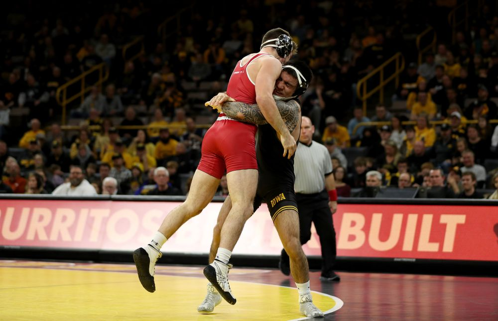 IowaÕs Pat Lugo wrestles WisconsinÕs Cole Martin at 149 pounds Sunday, December 1, 2019 at Carver-Hawkeye Arena. Lugo won the match 5-3. (Brian Ray/hawkeyesports.com)
