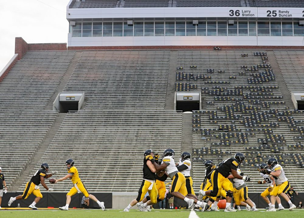 Iowa Hawkeyes quarterback Connor Kapisak (11) hands the ball off to running back Toren Young (28) during Fall Camp Practice No. 12 at Kinnick Stadium in Iowa City on Thursday, Aug 15, 2019. (Stephen Mally/hawkeyesports.com)