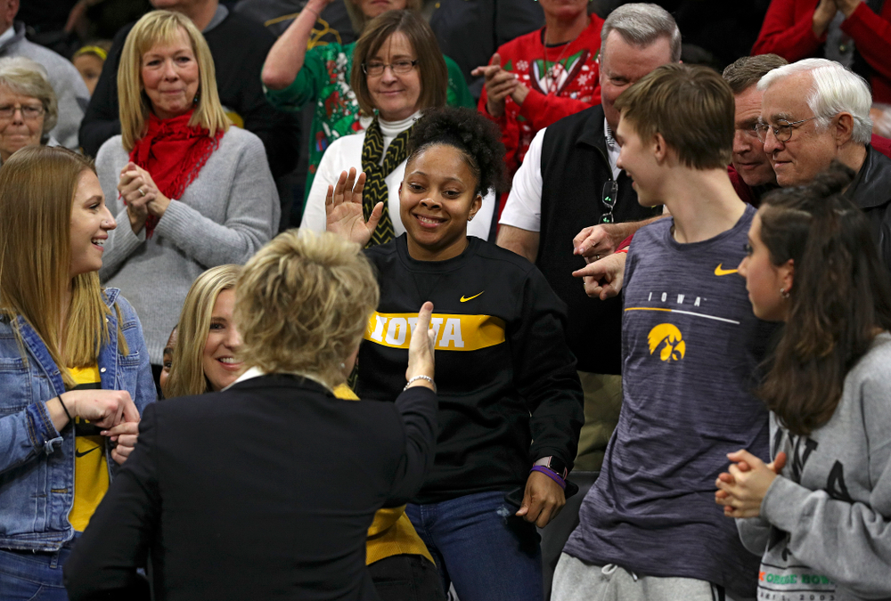 Former Iowa Hawkeyes player Tania Davis shakes hands with head coach Lisa Bluder before their game at Carver-Hawkeye Arena in Iowa City on Saturday, December 21, 2019. (Stephen Mally/hawkeyesports.com)