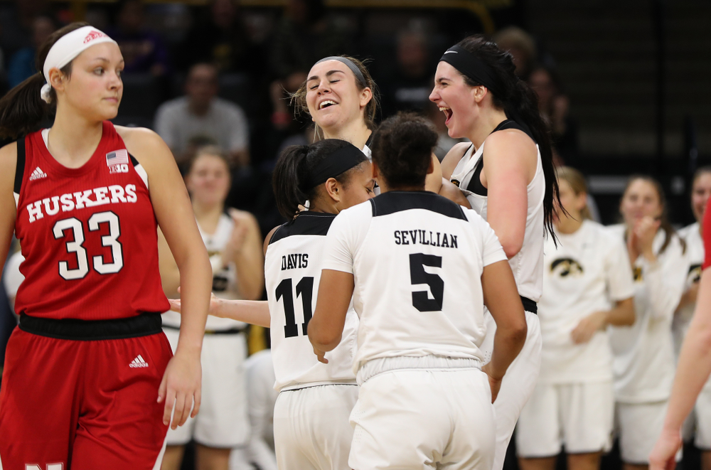 Iowa Hawkeyes forward Megan Gustafson (10), forward Hannah Stewart (21), guard Tania Davis (11), and guard Alexis Sevillian (5) against the Nebraska Cornhuskers Thursday, January 3, 2019 at Carver-Hawkeye Arena. (Brian Ray/hawkeyesports.com)