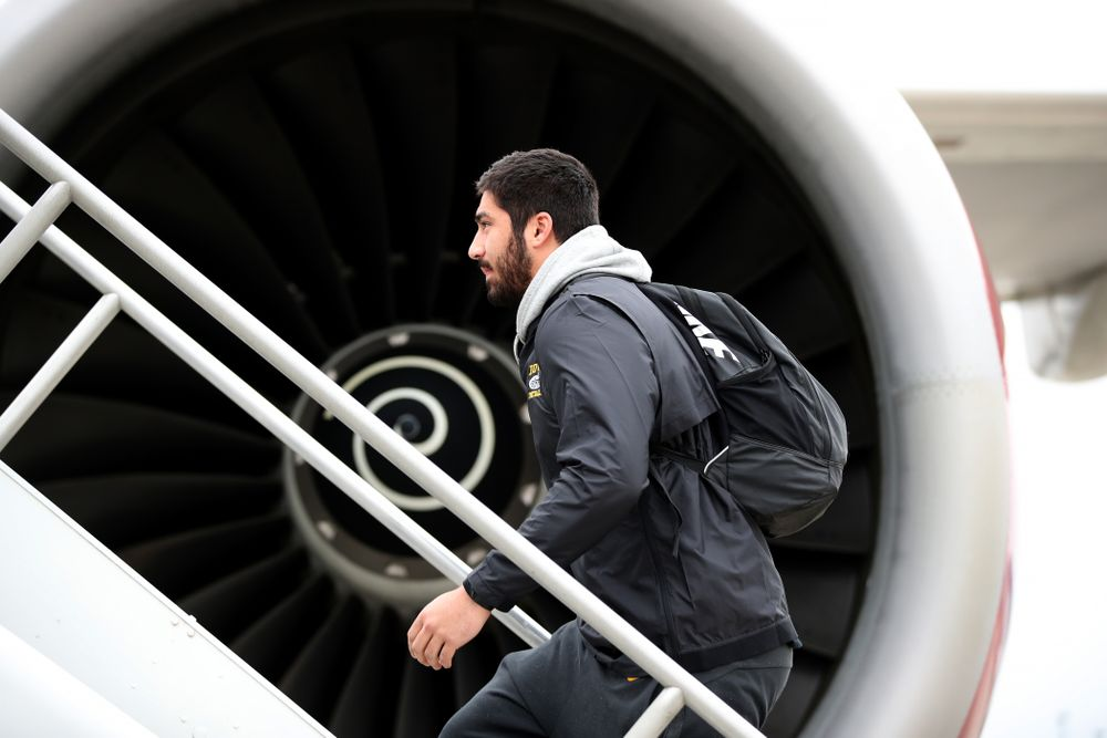 Iowa Hawkeyes defensive end A.J. Epenesa (94) boards the team plane Wednesday, December 26, 2018 as they travel to Tampa, Florida for the Outback Bowl. (Brian Ray/hawkeyesports.com)