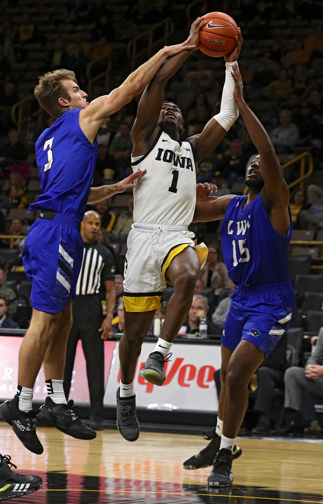 Iowa Hawkeyes guard Joe Toussaint (1) is fouled as he shoots during the second half of their exhibition game against Lindsey Wilson College at Carver-Hawkeye Arena in Iowa City on Monday, Nov 4, 2019. (Stephen Mally/hawkeyesports.com)
