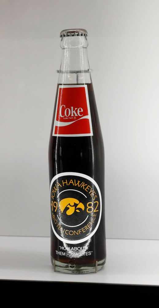 Coke bottle with Tigerhawk logo at the College Football Hall of Fame.