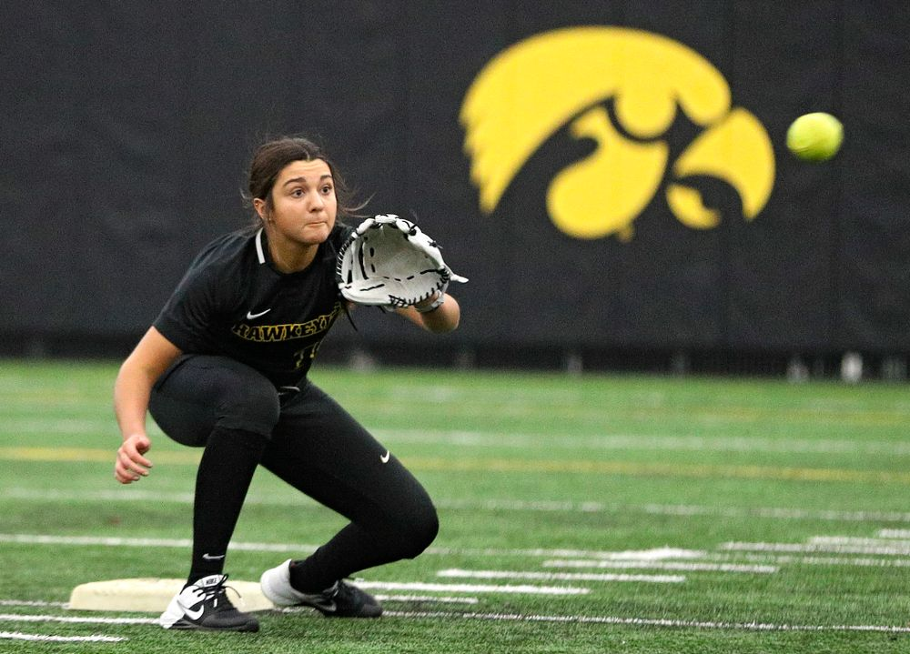 Iowa infielder Nicole Yoder (10) looks in a throw as they run a drill during Iowa Softball Media Day at the Hawkeye Tennis and Recreation Complex in Iowa City on Thursday, January 30, 2020. (Stephen Mally/hawkeyesports.com)