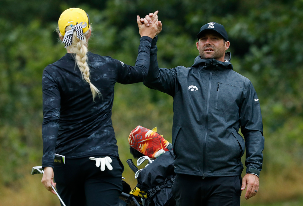Iowa women's golf assistant coach Michael Roters congratulates Shawn Rennegarbe after her round during the final round of the Diane Thomason Invitational at Finkbine Golf Course on September 30, 2018. (Tork Mason/hawkeyesports.com)
