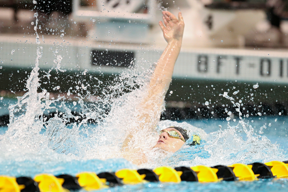 Iowa's Ryan Purdy swims the backstroke section in the men's 400 yard medley relay event during their meet at the Campus Recreation and Wellness Center in Iowa City on Friday, February 7, 2020. (Stephen Mally/hawkeyesports.com)