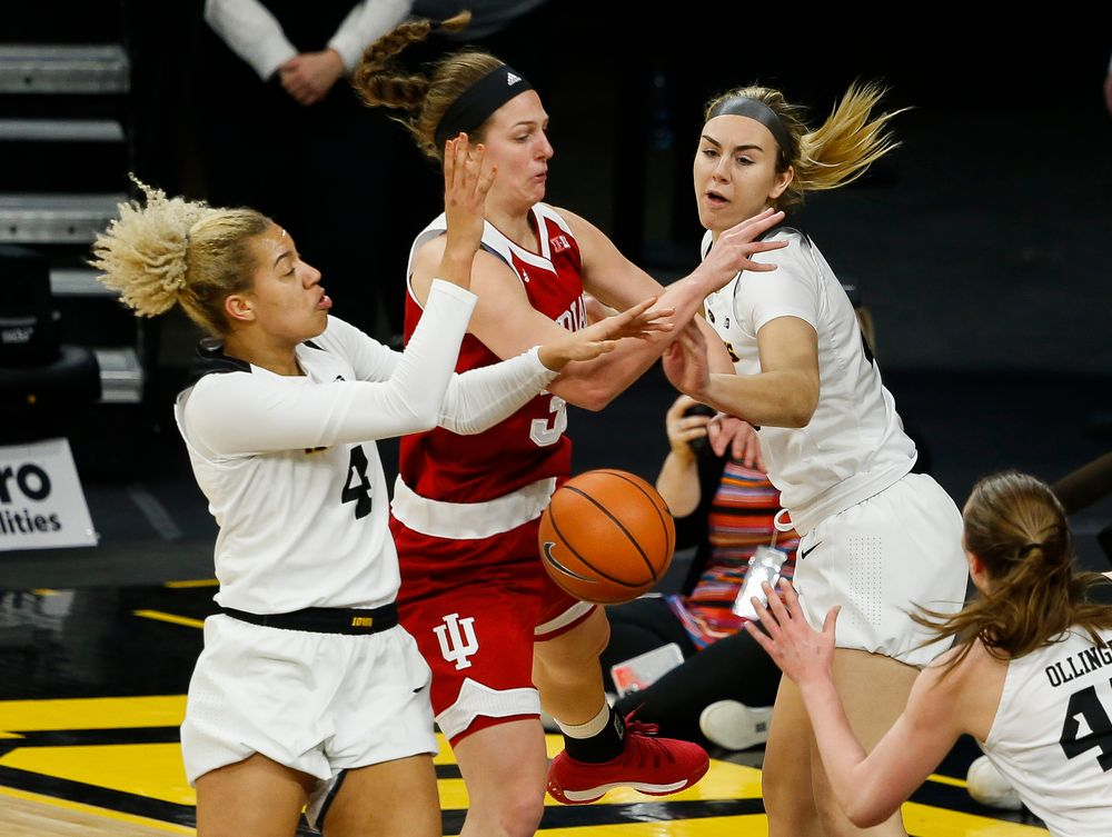 Iowa Hawkeyes forward Chase Coley (4), Iowa Hawkeyes forward Hannah Stewart (21)
