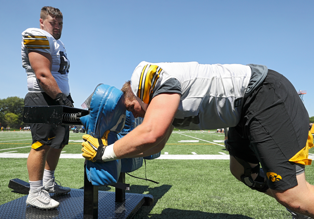 Iowa Hawkeyes defensive lineman Dalles Jacobus (66) looks on as defensive lineman Austin Schulte (74) hits a sled during Fall Camp Practice No. 7 at the Hansen Football Performance Center in Iowa City on Friday, Aug 9, 2019. (Stephen Mally/hawkeyesports.com)