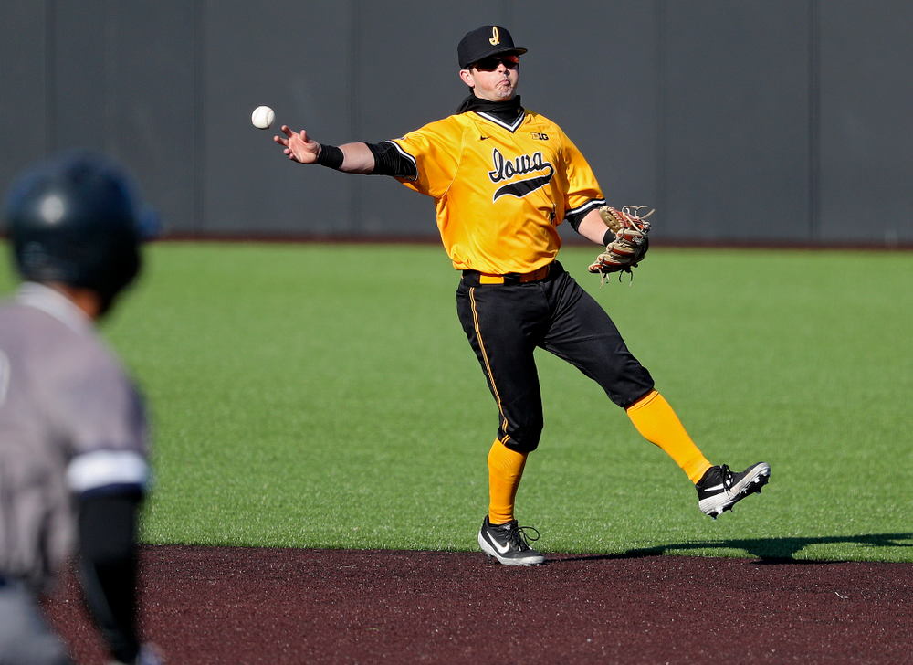 Iowa Hawkeyes second baseman Mitchell Boe (4) throws to first for an out during the fourth inning of their game at Duane Banks Field in Iowa City on Tuesday, Apr. 2, 2019. (Stephen Mally/hawkeyesports.com)
