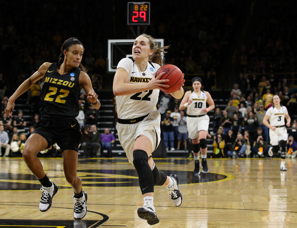 Iowa Hawkeyes guard Kathleen Doyle (22) drives in to the basket after a steal during the fourth quarter of their second round game in the 2019 NCAA Women's Basketball Tournament at Carver Hawkeye Arena in Iowa City on Sunday, Mar. 24, 2019. (Stephen Mally for hawkeyesports.com)
