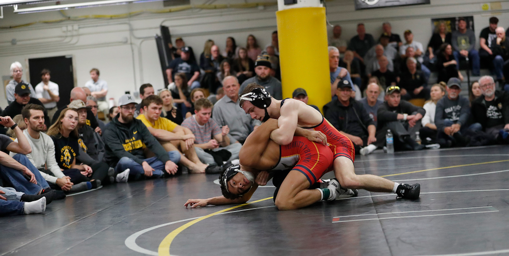 Aaron Cashman and Spencer Lee wrestle in front of a packed house at the Dan Gable Wrestling Complex.