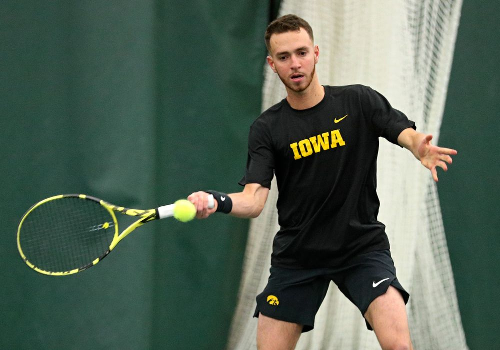 Iowa's Kareem Allaf returns a shot during his singles match at the Hawkeye Tennis and Recreation Complex in Iowa City on Friday, February 14, 2020. (Stephen Mally/hawkeyesports.com)