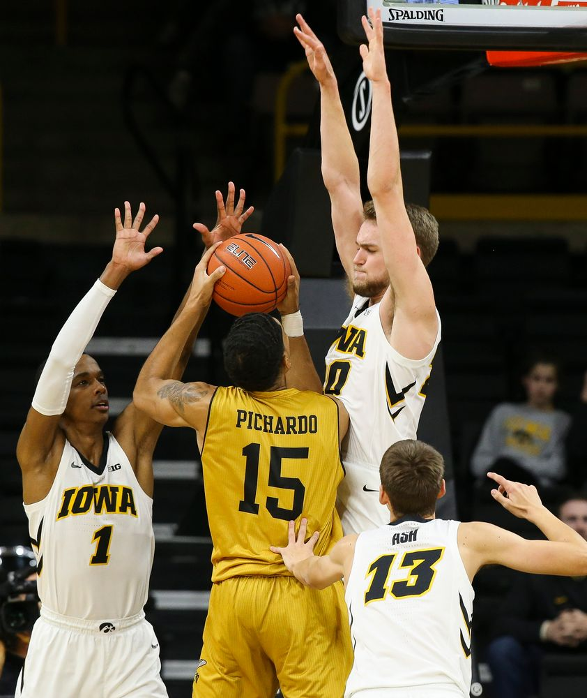 Iowa Hawkeyes guard Maishe Dailey (1) and Iowa Hawkeyes forward Riley Till (20) contest a shot during a game against Alabama State at Carver-Hawkeye Arena on November 21, 2018. (Tork Mason/hawkeyesports.com)