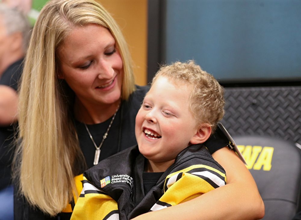 Kid Captain Cooper Leeman is all smiles in the Iowa locker room during Kids Day at Kinnick Stadium in Iowa City on Saturday, Aug 10, 2019. (Stephen Mally/hawkeyesports.com)