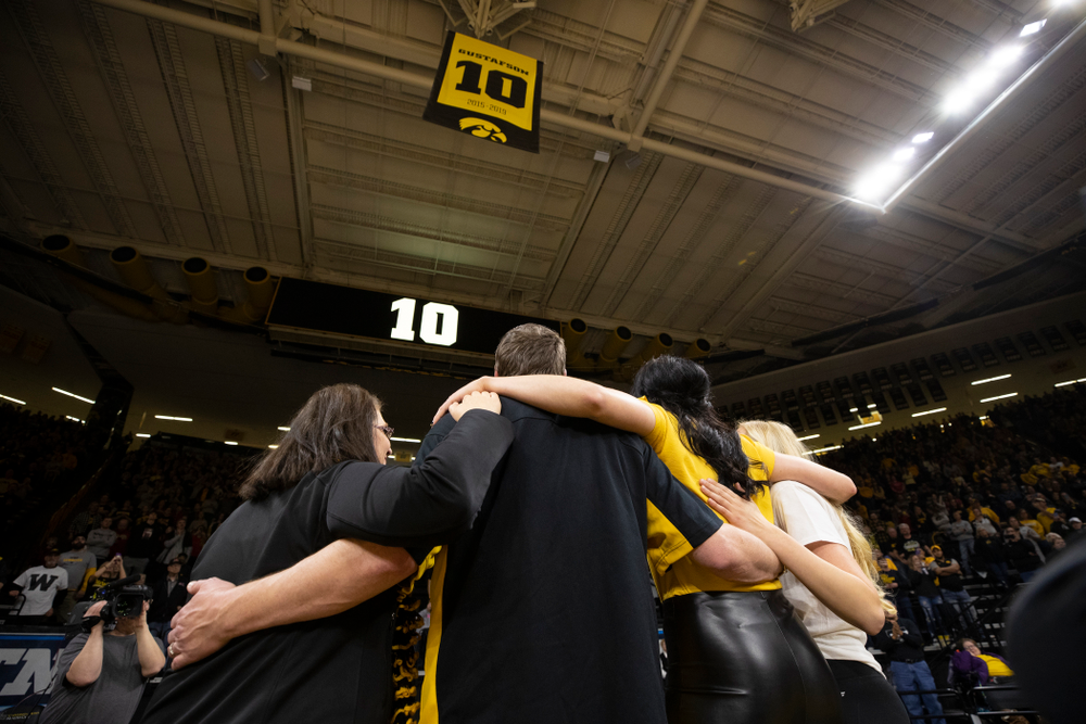 Megan Gustafson stands with her family as her number is raised into the rafters during a jersey retirement ceremony Sunday, January 26, 2020 at Carver-Hawkeye Arena. (Brian Ray/hawkeyesports.com)