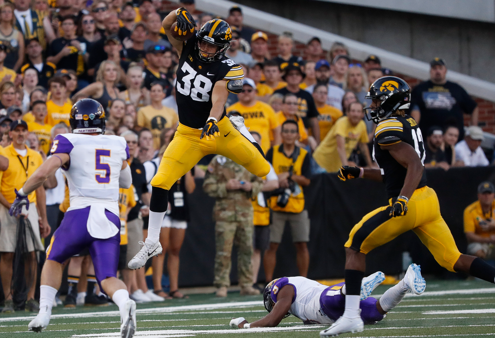 Iowa Hawkeyes tight end T.J. Hockenson (38) hurdles a defender during a game against Northern Iowa at Kinnick Stadium on September 15, 2018. (Tork Mason/hawkeyesports.com)