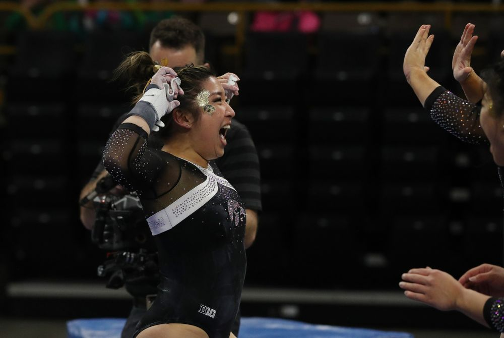 Iowa's Nicole Chowl competes on the bars against the Rutgers Scarlet Knights Saturday, January 26, 2019 at Carver-Hawkeye Arena. (Brian Ray/hawkeyesports.com)