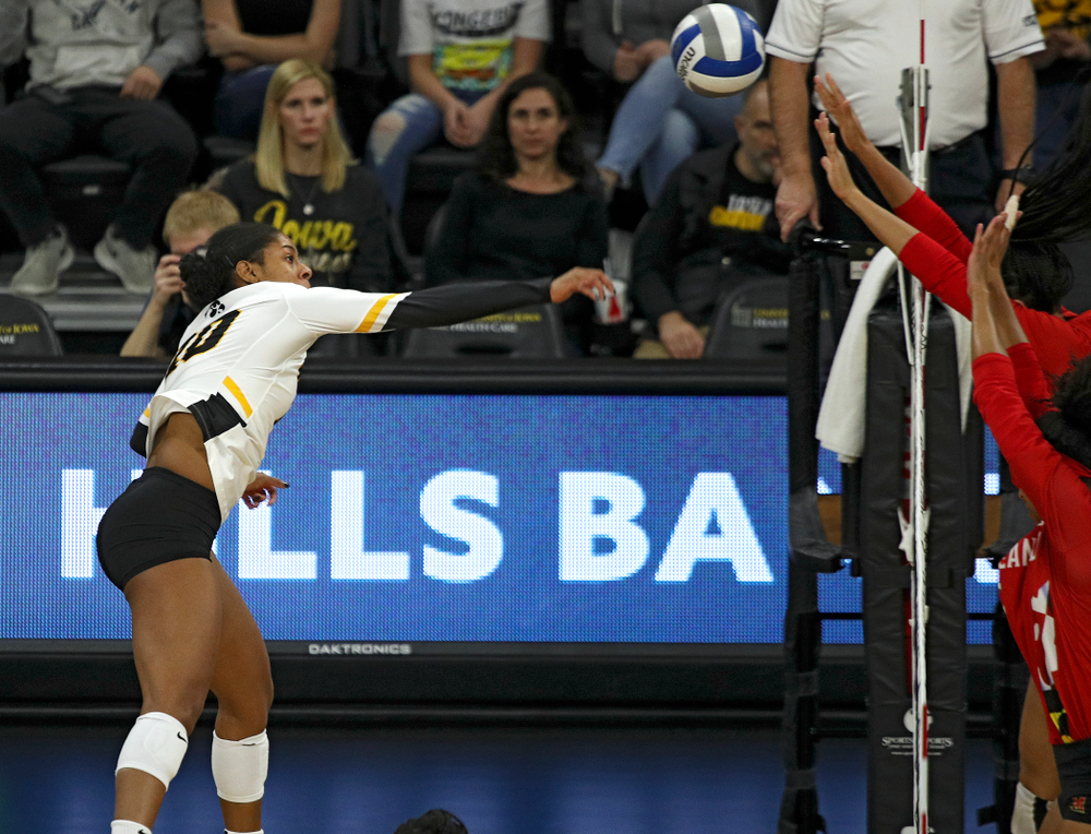 Iowa's Griere Hughes (10) sends a kill over during the first set of their match at Carver-Hawkeye Arena in Iowa City on Saturday, Nov 30, 2019. (Stephen Mally/hawkeyesports.com)