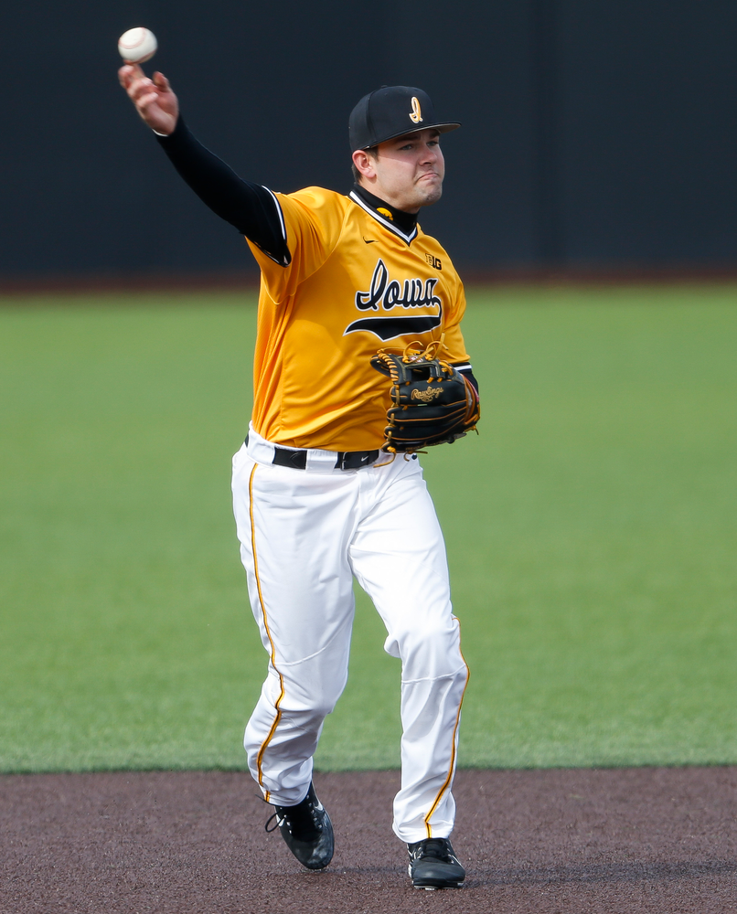 Iowa Hawkeyes infielder Kyle Crowl (23) throws to first base during a game against Evansville at Duane Banks Field on March 18, 2018. (Tork Mason/hawkeyesports.com)