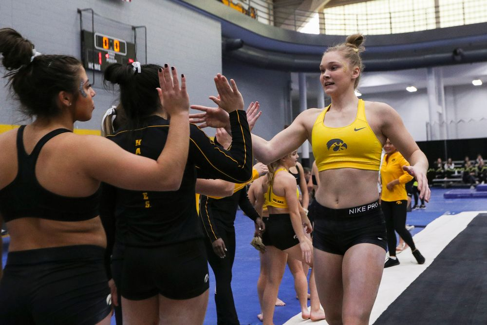 Allyson Steffensmeier high fives teammates during the Iowa women's gymnastics Black and Gold Intraquad Meet on Saturday, December 7, 2019 at the UI Field House. (Lily Smith/hawkeyesports.com)