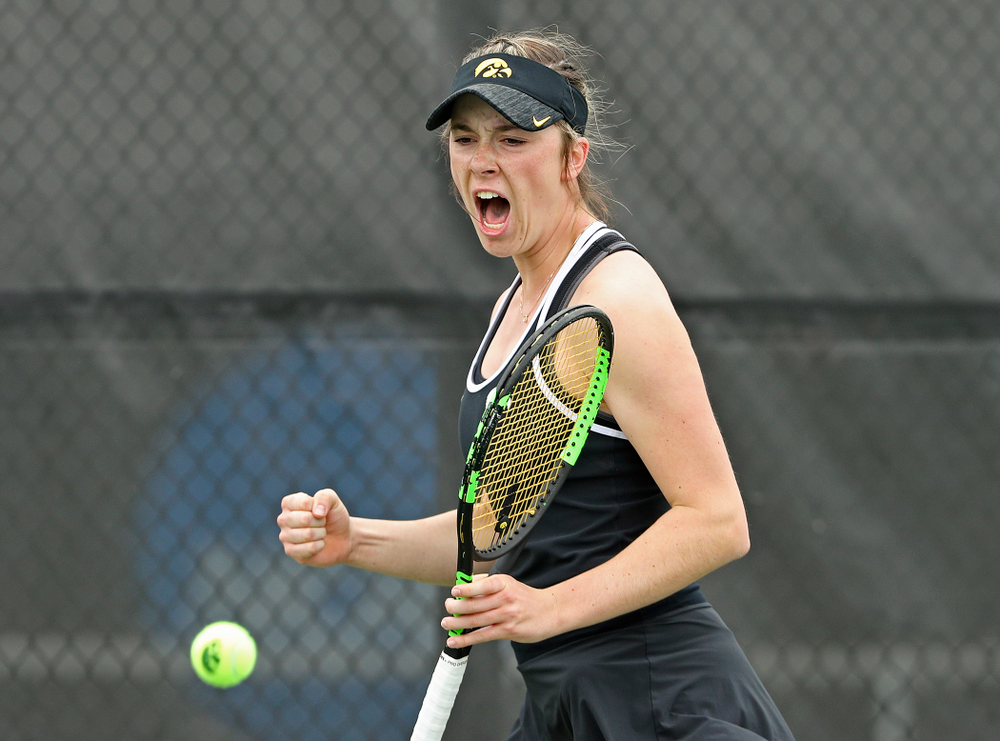 Iowa's Samantha Mannix celebrates as she watches the ball drop out of bounds during their doubles match against Rutgers at the Hawkeye Tennis and Recreation Complex in Iowa City on Friday, Apr. 5, 2019. (Stephen Mally/hawkeyesports.com)