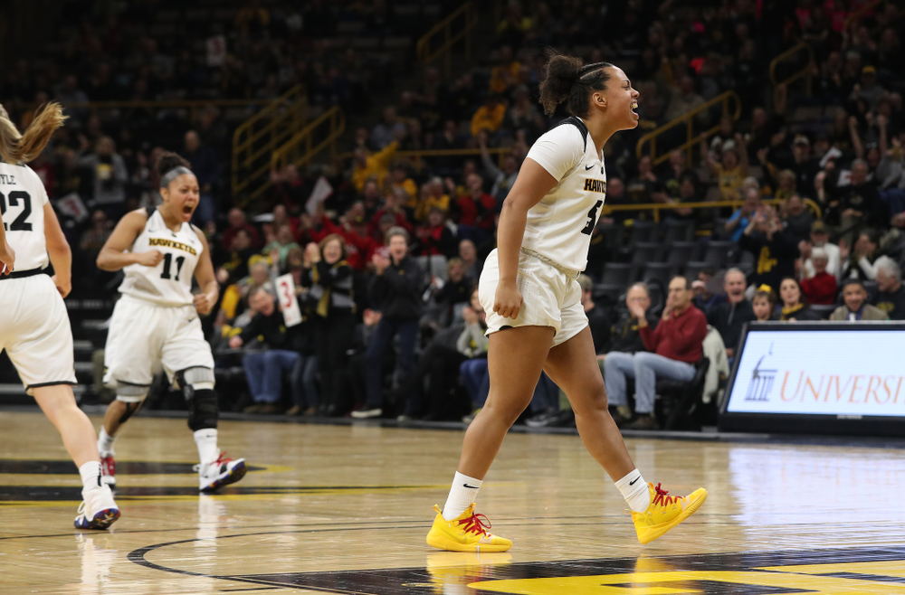 Iowa Hawkeyes guard Alexis Sevillian (5) reacts to an and one by forward Hannah Stewart (21) against the Purdue Boilermakers Sunday, January 27, 2019 at Carver-Hawkeye Arena. (Brian Ray/hawkeyesports.com)