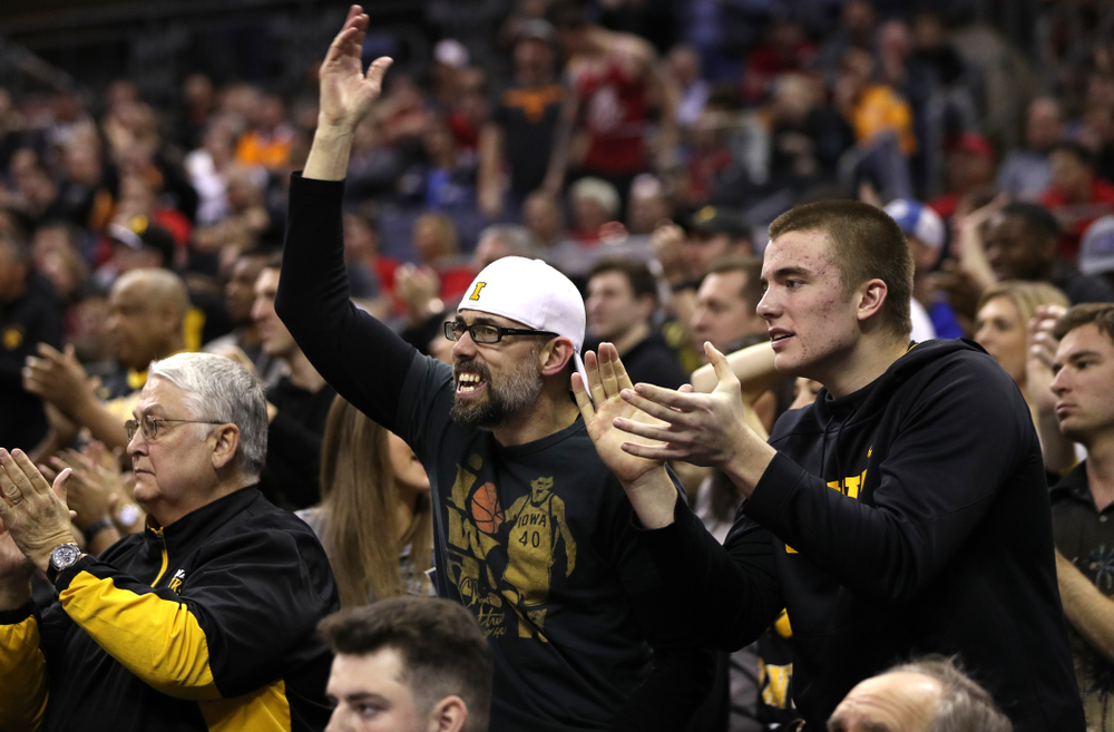 Fans cheer on the Iowa Hawkeyes against the Cincinnati Bearcats in the first round of the 2019 NCAA Men's Basketball Tournament Friday, March 22, 2019 at Nationwide Arena in Columbus, Ohio. (Brian Ray/hawkeyesports.com)