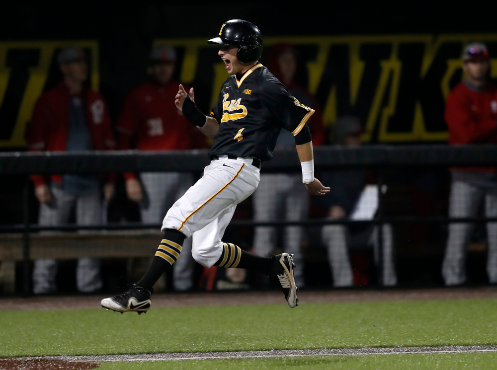 Iowa Hawkeyes infielder Mitchell Boe (4) celebrates as he scores on a walk off grand slam by catcher Tyler Cropley (5) against the Bradley Braves Wednesday, March 28, 2018 at Duane Banks Field. (Brian Ray/hawkeyesports.com)