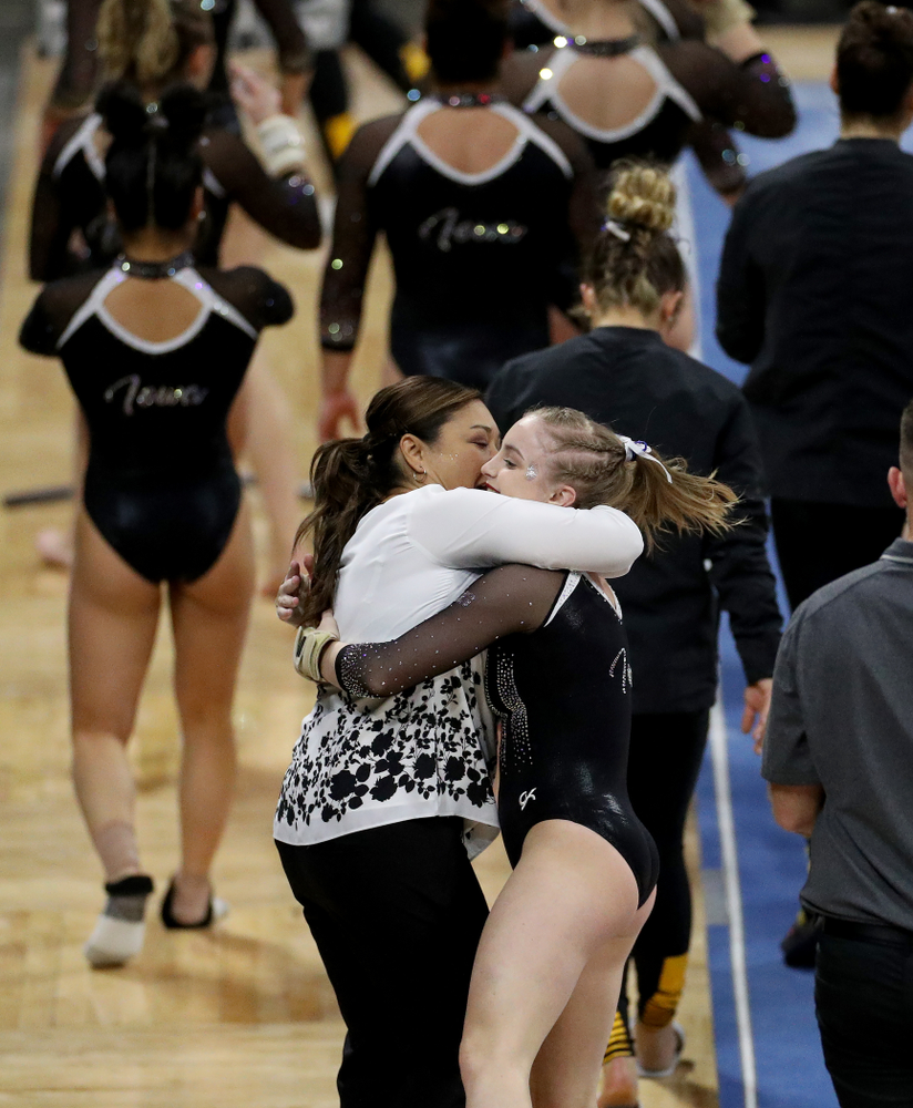 Iowa's Head Coach Larissa Libby hugs Lauren Guerin after her performance on the vault against Michigan State Saturday, February 1, 2020 at Carver-Hawkeye Arena. (Brian Ray/hawkeyesports.com)