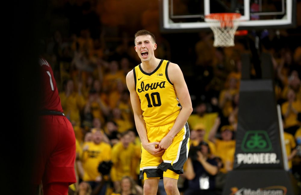 Iowa Hawkeyes guard Joe Wieskamp (10) celebrates after making his 100th career three point basket against the Rutgers Scarlet Knights  Wednesday, January 22, 2020 at Carver-Hawkeye Arena. (Brian Ray/hawkeyesports.com)