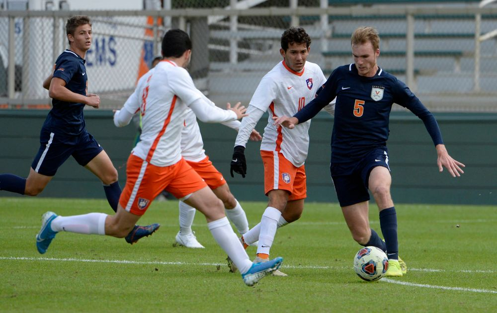 Virginia's Henry Kessler (5) and Clemson's Adrian Nuñez (10) battle for the ball during the 2019 ACC Men?s Soccer Championship at WakeMed Soccer Park in Cary, N.C., Sunday Nov. 17, 2019. (Photo by Sara D. Davis, the ACC)