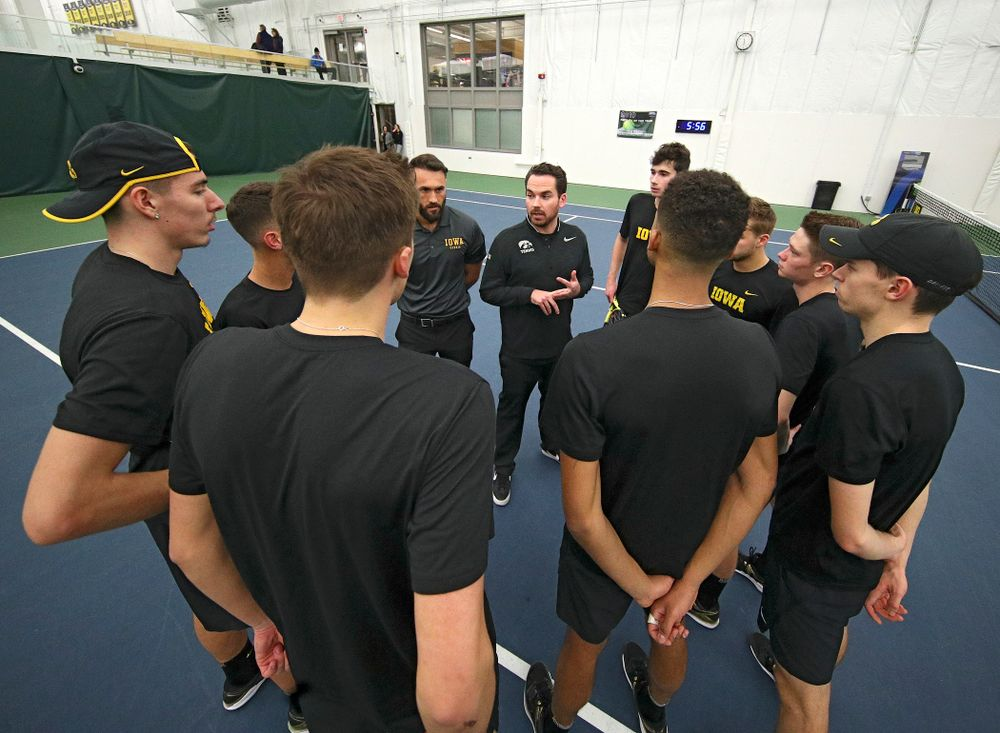 Mellecker Family Head Men's Tennis Coach Ross Wilson talks with his team before their match at the Hawkeye Tennis and Recreation Complex in Iowa City on Friday, February 14, 2020. (Stephen Mally/hawkeyesports.com)