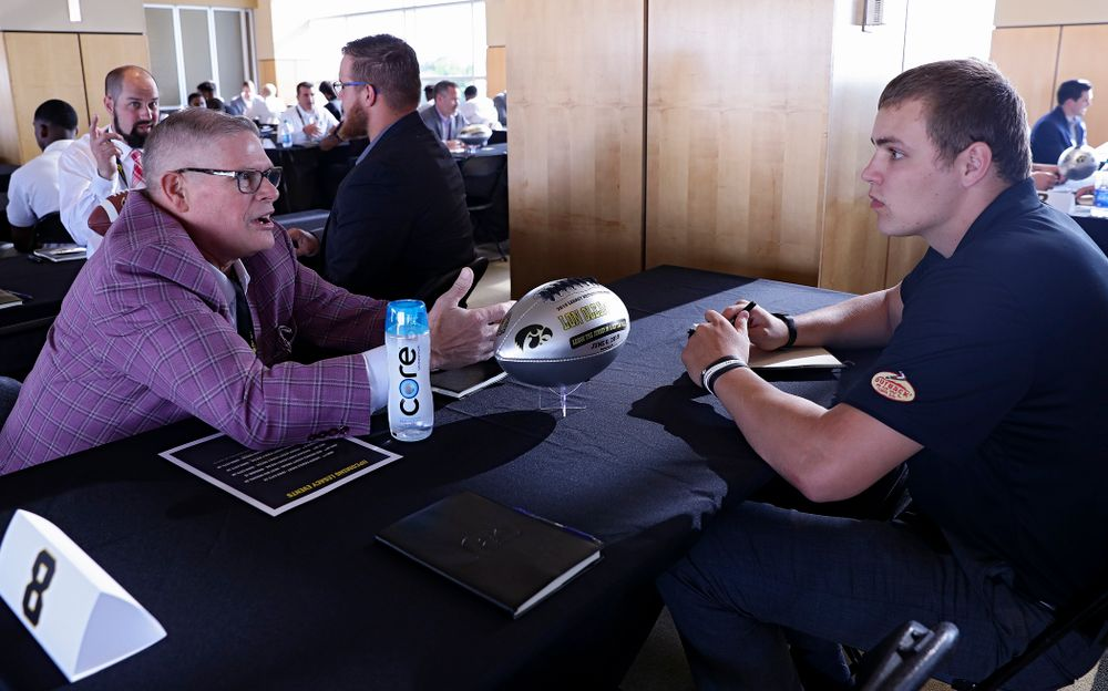 Lon Olejniczak (from left), former Iowa tight end, talks with quarterback Nate Stanley as former players meet with members of the current Hawkeye Football team during a networking event at Kinnick Stadium in Iowa City on Thursday, Jun 6, 2019. (Stephen Mally/hawkeyesports.com)