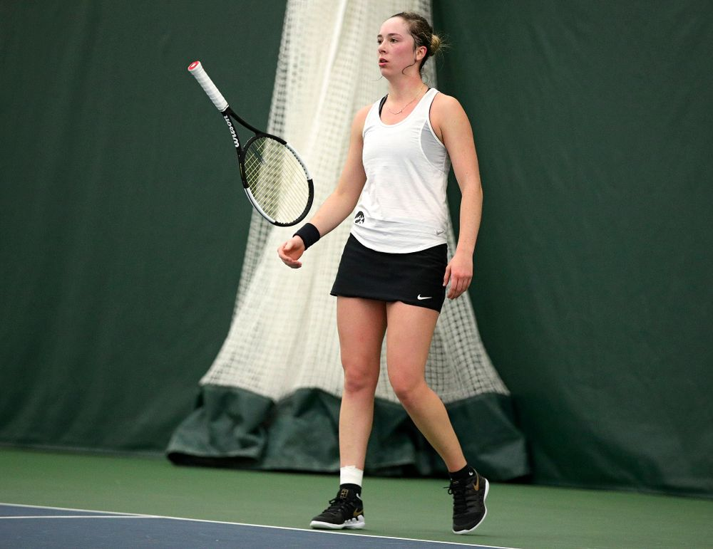 Iowa's Samantha Mannix flips her racket during her singles match at the Hawkeye Tennis and Recreation Complex in Iowa City on Sunday, February 23, 2020. (Stephen Mally/hawkeyesports.com)