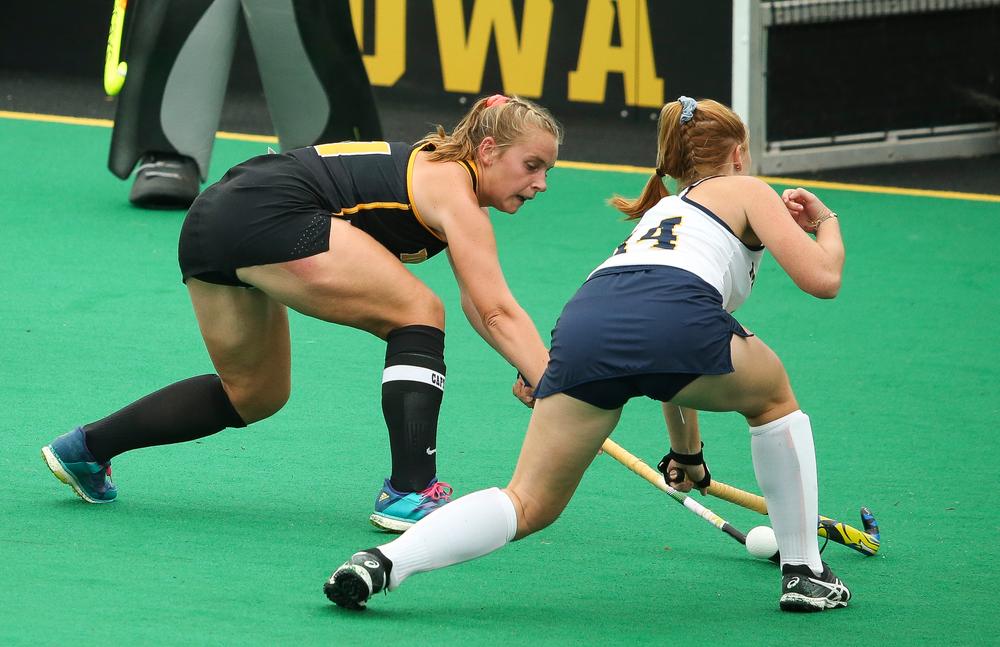Iowa Hawkeyes midfielder Katie Birch (11) defends during a game against Michigan at Grant Field on October 5, 2018. (Tork Mason/hawkeyesports.com)