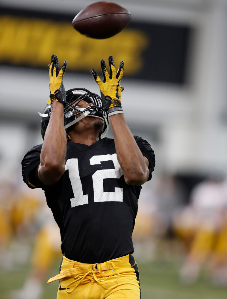 Iowa Hawkeyes wide receiver Brandon Smith (12) during spring practice Wednesday, March 28, 2018 at the Hansen Football Performance Center.  (Brian Ray/hawkeyesports.com)