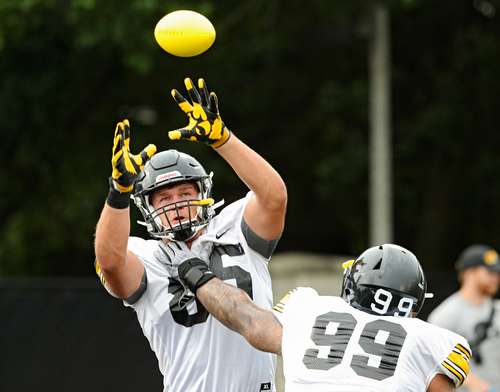 Iowa Hawkeyes defensive end Logan Lee (85) pulls in a ball as he runs a drill with defensive lineman Noah Shannon (99) durning Fall Camp Practice No. 17 at the Hansen Football Performance Center in Iowa City on Wednesday, Aug 21, 2019. (Stephen Mally/hawkeyesports.com)