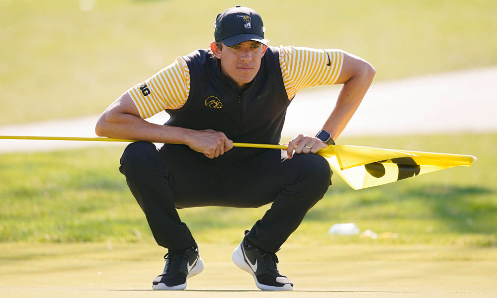 Iowa assistant coach Charlie Hoyle reads the green during the third round of the Hawkeye Invitational at Finkbine Golf Course in Iowa City on Sunday, Apr. 21, 2019. (Stephen Mally/hawkeyesports.com)