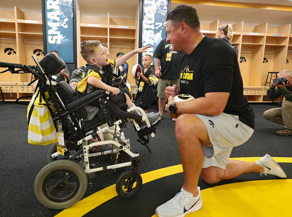 Kid Captain Cien Currie interacts with Iowa Hawkeyes offensive coordinator Brian Ferentz during Kids Day at Kinnick Stadium in Iowa City on Saturday, Aug 10, 2019. (Stephen Mally/hawkeyesports.com)