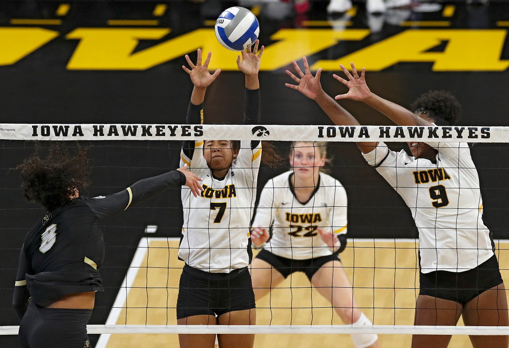 Iowa's Brie Orr (7) gets her fingers on a shot as Jaedynn Evans (22) and Amiya Jones (9) look on during the second set of their Big Ten/Pac-12 Challenge match against Colorado at Carver-Hawkeye Arena in Iowa City on Friday, Sep 6, 2019. (Stephen Mally/hawkeyesports.com)